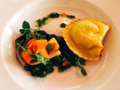 Chèvre raviolo, spring carrot salad, grilled ramps, cress pesto, pea vines
