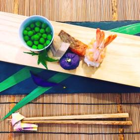 Assortment of Appetizer (Hassun): Green peas, Samurai helmet shaped shrimp sushi, Arrow feather shaped lotus root, Grilled Alaskan sockeye salmon, Iris shaped purple yam