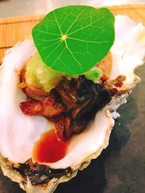 Appetizer: Grilled oyster mixed with grated daikon and jalapeno