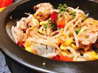 The chicken pieces from the Steam Pot Chicken were then spiced with red green chili peppers and green peppercorns